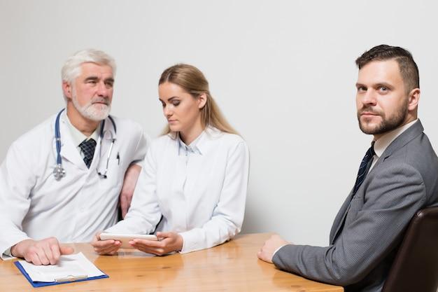 Closeup businessman table business stethoscope doctor
