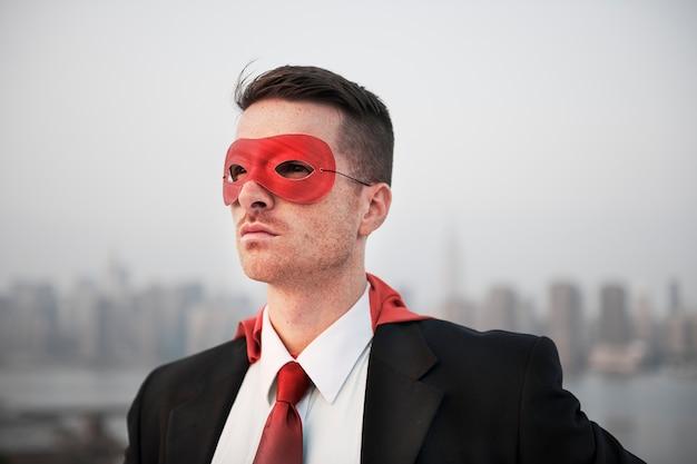 Closeup of businessman wearing red superhero costume