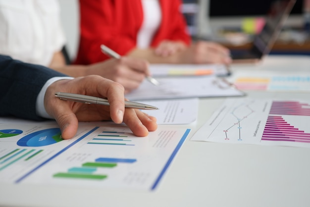 Closeup of businesspeople meeting for data analysis charts