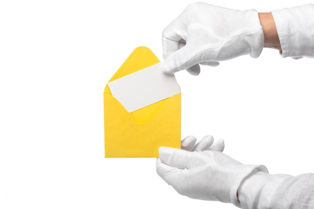 Closeup of a butler holding an envelope. man is unrecognizable