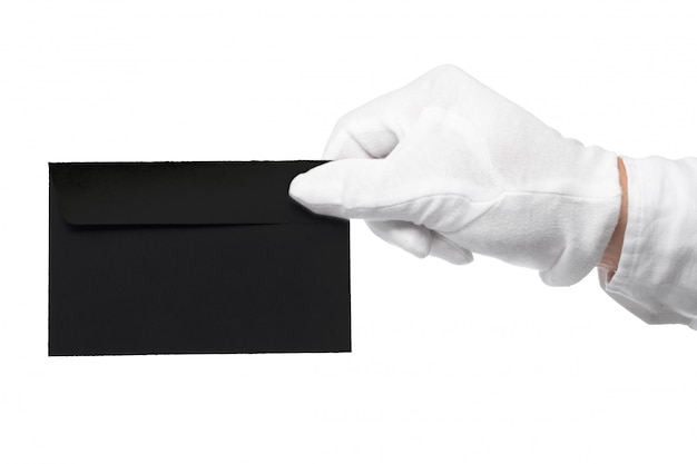 Closeup of a butler holding an envelope