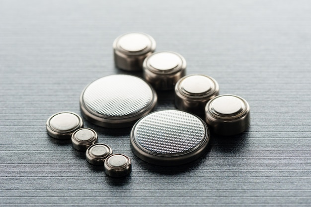 Батарея клетки кнопки крупного плана или батарея вахты или элемент монеты