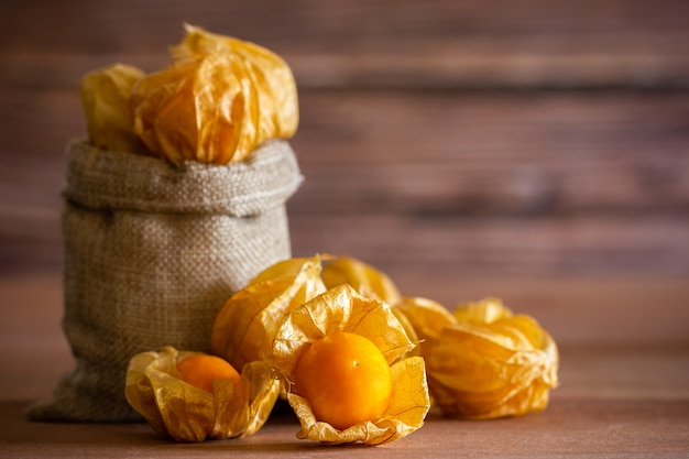 Closeup cape gooseberry in burlap bags.
