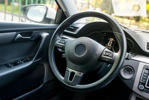Closeup on car steering wheel, salon design