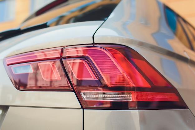 Closeup of car tail light on a white car..