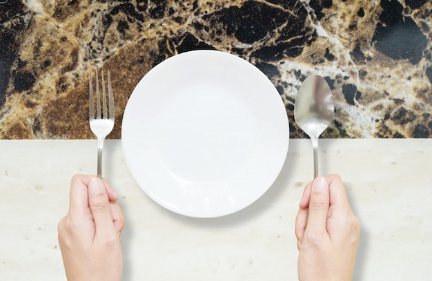 Closeup ceramic dish on marble table textured background