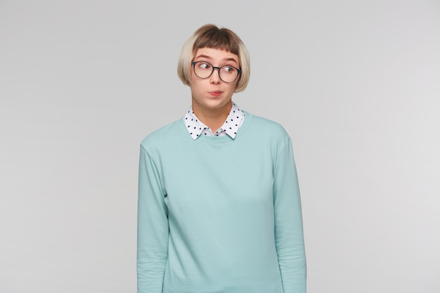 Closeup of cheerful beautiful young woman wears blue sweatshirt