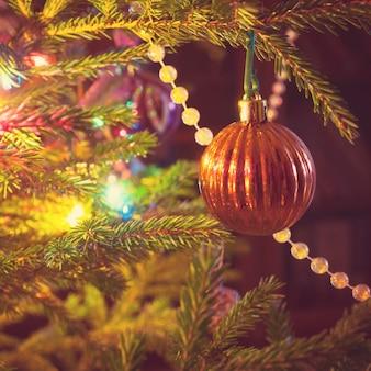 Closeup of christmas tree decorations. vintage toned