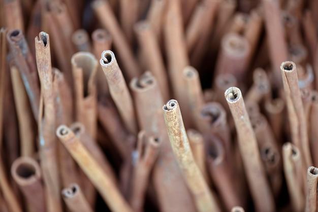 Closeup of cinnamon sticks at outdoor market stall