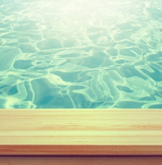 Closeup clear wooden studio background beside swimming pool - well use for present products.