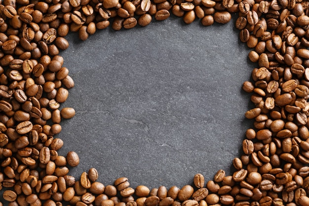 Closeup of coffee beans background. view from above