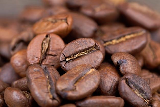 おいしいコーヒー、生または焙煎された形の芳香性コーヒー豆の生産のためのクローズアップコーヒー豆