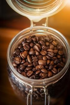 Closeup coffee beans in glass jar