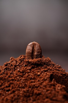 Closeup of coffee beans at the mixed heap of roasted coffee with copy space for text.