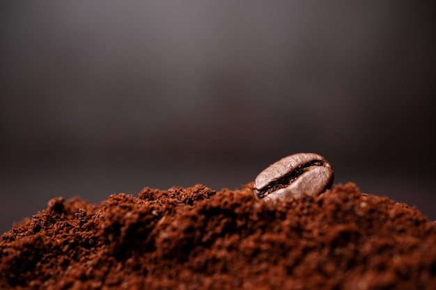 Closeup of coffee beans at the mixed heap of roasted coffee with copy space