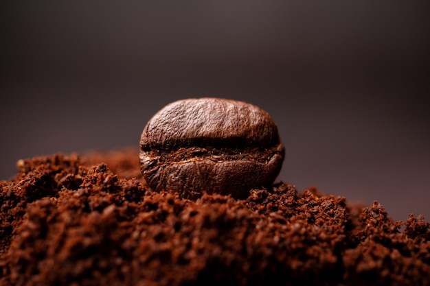Closeup of coffee beans at the mixed heap of roasted coffee