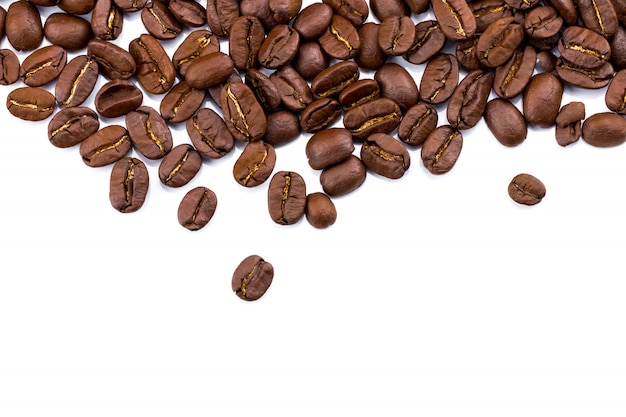 Closeup of coffee beans on white background. copy space