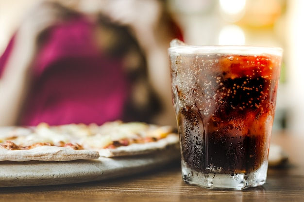 Closeup cola or soft drink in a glass with ices