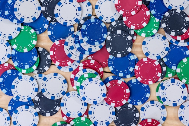 Closeup on colorful casino chips on wooden desk