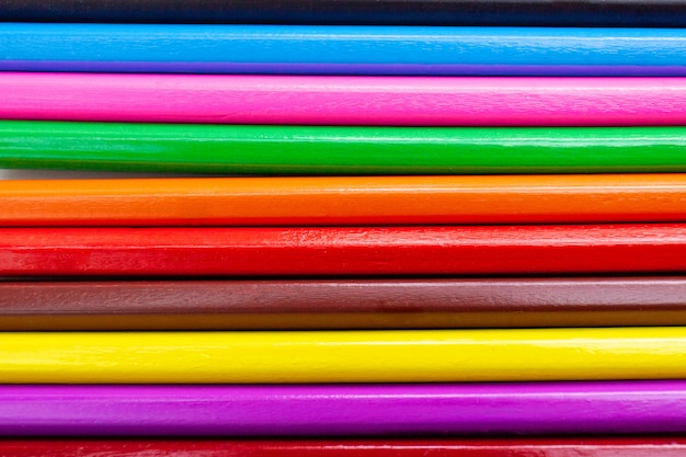 Closeup colorful pencils abstract pattern background.
