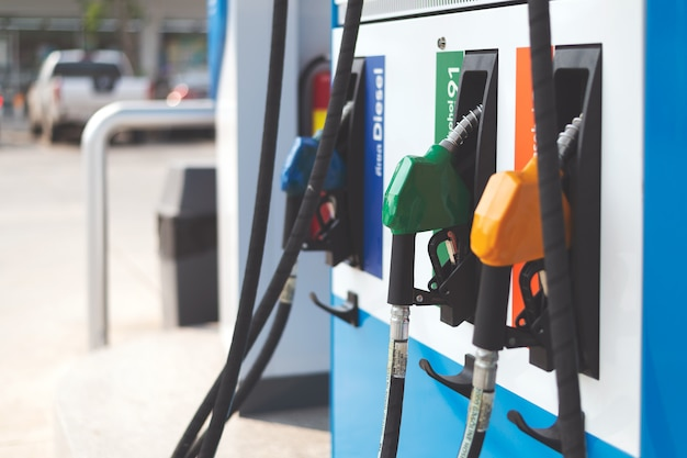 Closeup of colourful fuel pumps at a gas station
