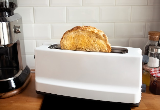 Closeup cooking bread with toaster on counter bar kitchen in morning