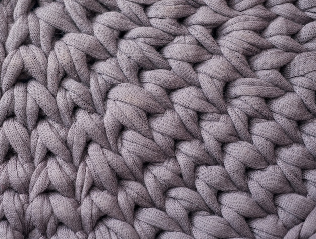 Closeup cotton grey knit blanket, warm and comfortable