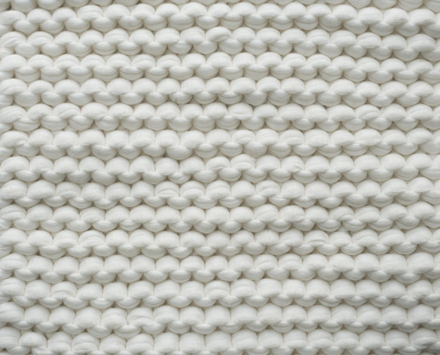 Closeup cotton white knit blanket, warm and comfortable atmosphere.