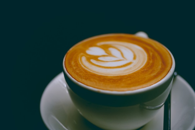 Closeup of a cup of delicious latte on a saucer
