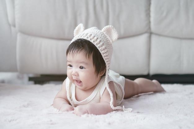 Closeup cute baby girl in funny motion Premium Photo