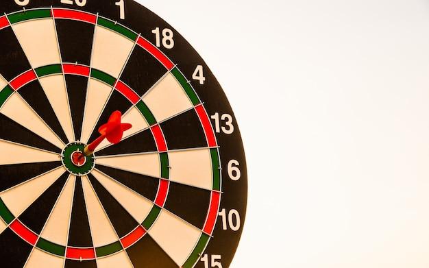 Closeup the dart arrow hit center on bullseyebullseye of a dartboard is a target of challenge business