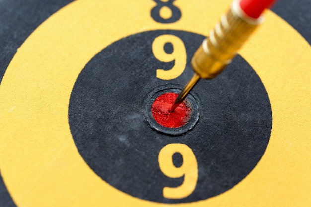 Closeup dart hitting on bullseye target