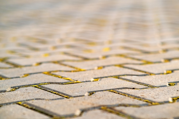 Closeup detail of gray concrete yard pavement slabs.