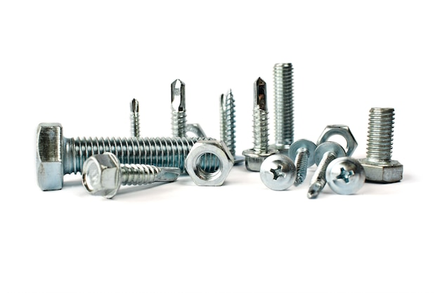 Closeup of different types of fasteners isolated on white. isolated fasteners. connecting material on white background