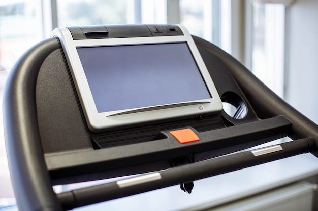 Closeup of the display of the treadmill in the fitness room.