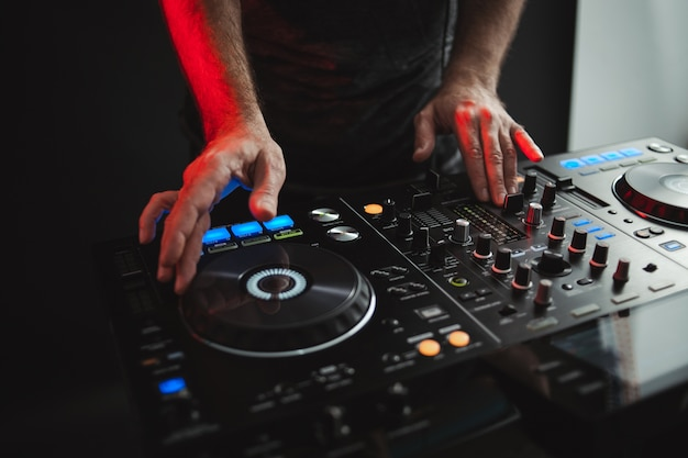 Closeup of a dj working in studio