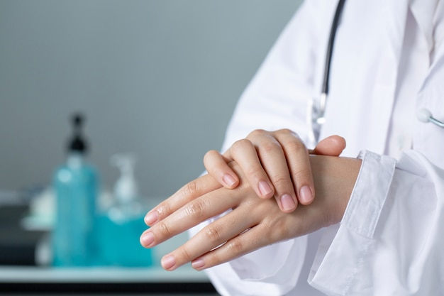 Closeup doctor hands washing  with hand sanitizer gel.coronavirus hand washing for clean hands hygiene covid19 spread prevention