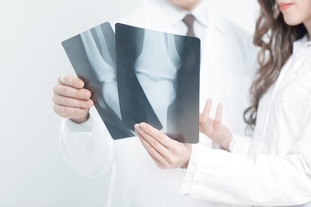 Closeup.doctors are diagnosticians discussing x ray of patient