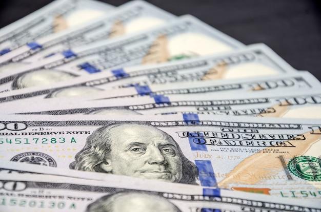 Доллары крупным планом на черном