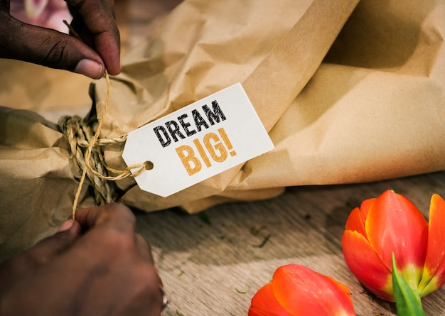 Closeup of dream big tag on a flower bouquet
