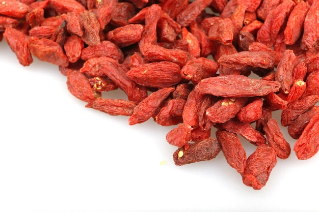 Closeup of dried goji berries under the lights isolated on a white background