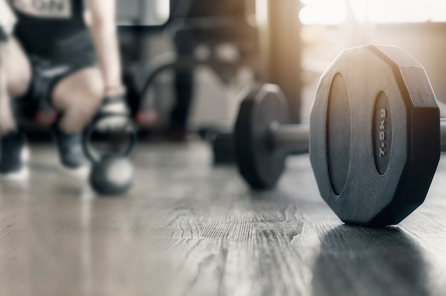 Closeup of dumbbell on the floor in gym, copy space