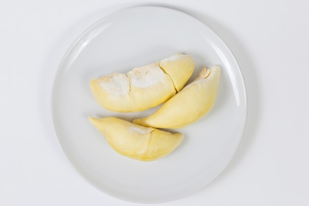 Closeup durian sweet fruit on dish, white background