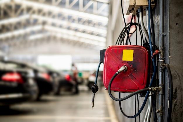 Closeup electrical plugs in car garage