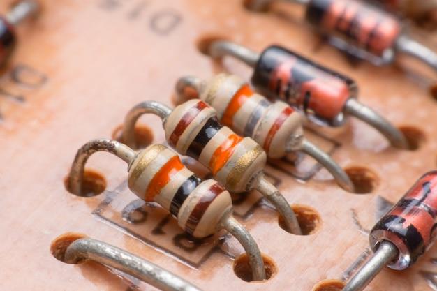 Closeup electronic hardware .resistor on the circuit board