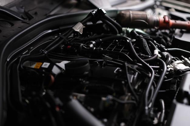 Closeup of electronics under hood of car