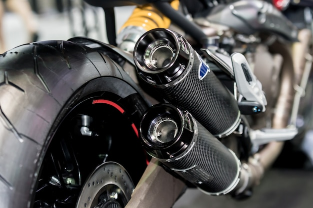 Closeup of exhaust or intake of racing motorcycle. low angle photograph of motorcycle.