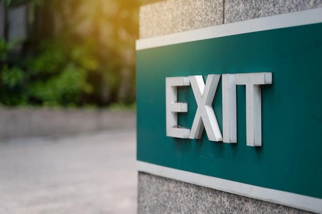 Closeup exit door emergency fire exit sign in condo