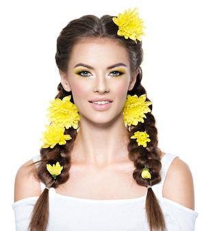 Closeup face of an young smiling beautiful woman with bright yellow makeup fashion portrait attractive girl with stylish hairstyle pigtails    isolated on white professional  makeup