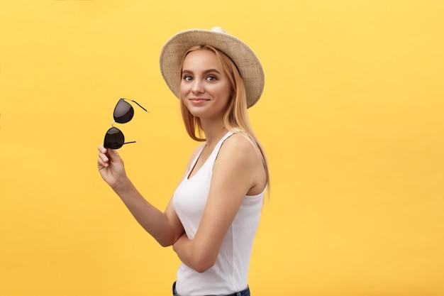 Closeup fashion studio portrait of hipster young woman